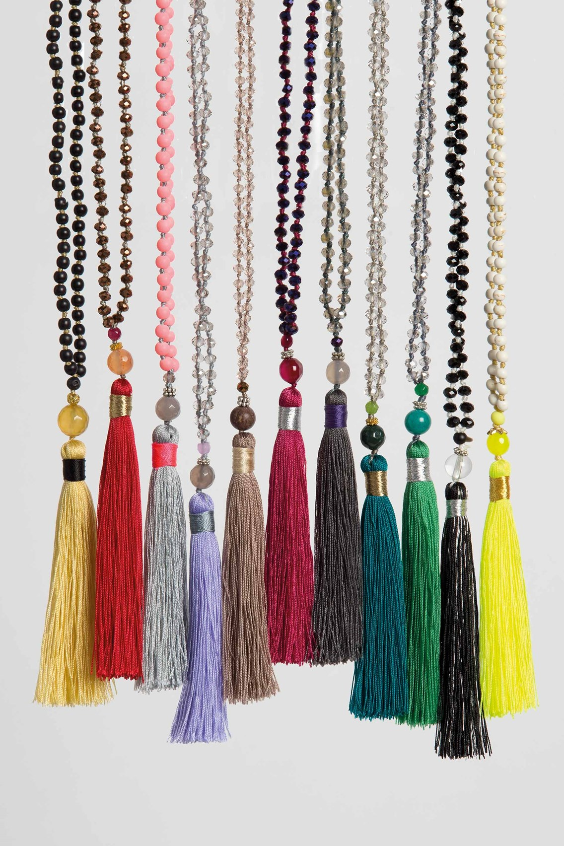 in front tassel beads necklace turk trina bloom pin